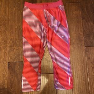 Nike cropped leggings orange and red striped sz M